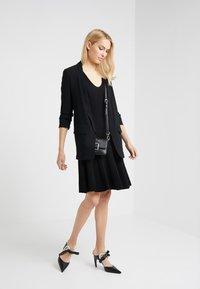 Steffen Schraut - DRESS SPECIAL - Pletené šaty - black - 1