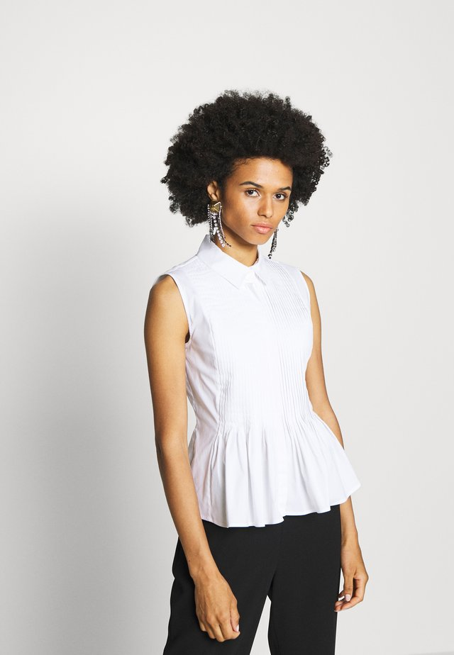 ECXLUSIVE BLOUSE SLEEVELESS - Button-down blouse - white