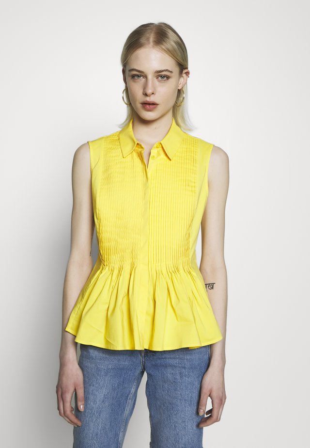 ECXLUSIVE BLOUSE SLEEVELESS - Button-down blouse - flash yellow