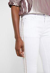 Steffen Schraut - CHERYL GLAM STRIPE PANTS - Slim fit jeans - white - 5