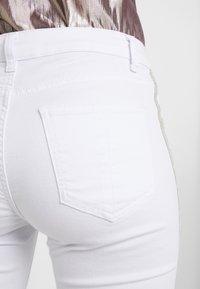 Steffen Schraut - CHERYL GLAM STRIPE PANTS - Slim fit jeans - white - 3