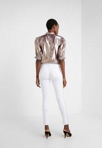 Steffen Schraut - CHERYL GLAM STRIPE PANTS - Slim fit jeans - white - 2