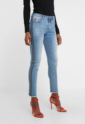 CHERYL GLAM STRIPE PANTS - Slim fit jeans - cool denim