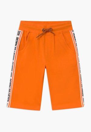 BERMUDAS KID - Träningsbyxor - orange