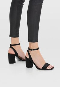 Stradivarius - High heeled sandals - black - 0