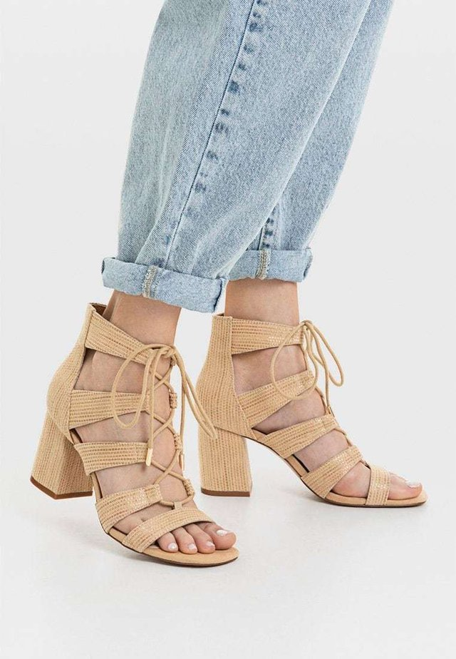 Ankle cuff sandals - beige