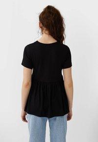 Stradivarius - BASIC-PEPLUM - T-shirts print - black - 2