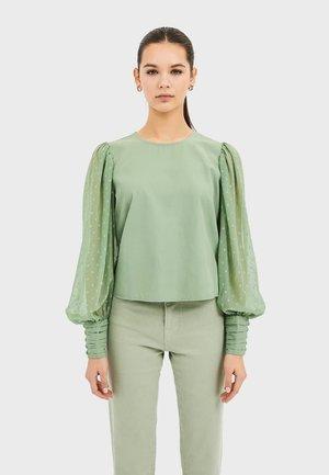 POPELINHEMD MIT PLUMETIS-ÄRMELN 02040579 - Camicetta - turquoise