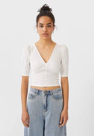 MIT V-AUSSCHNITT UND KNÖPFEN - T-shirt imprimé - white