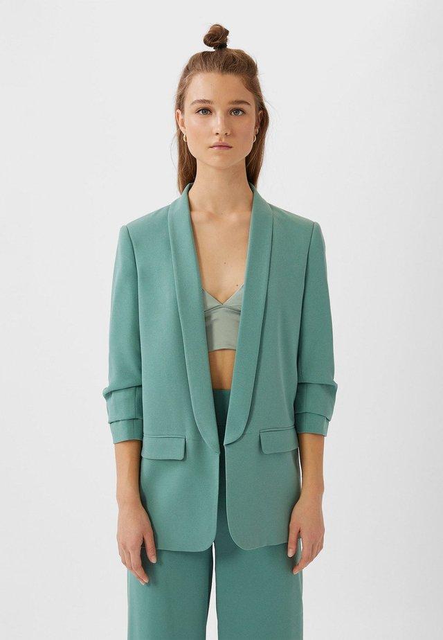 Halflange jas - turquoise