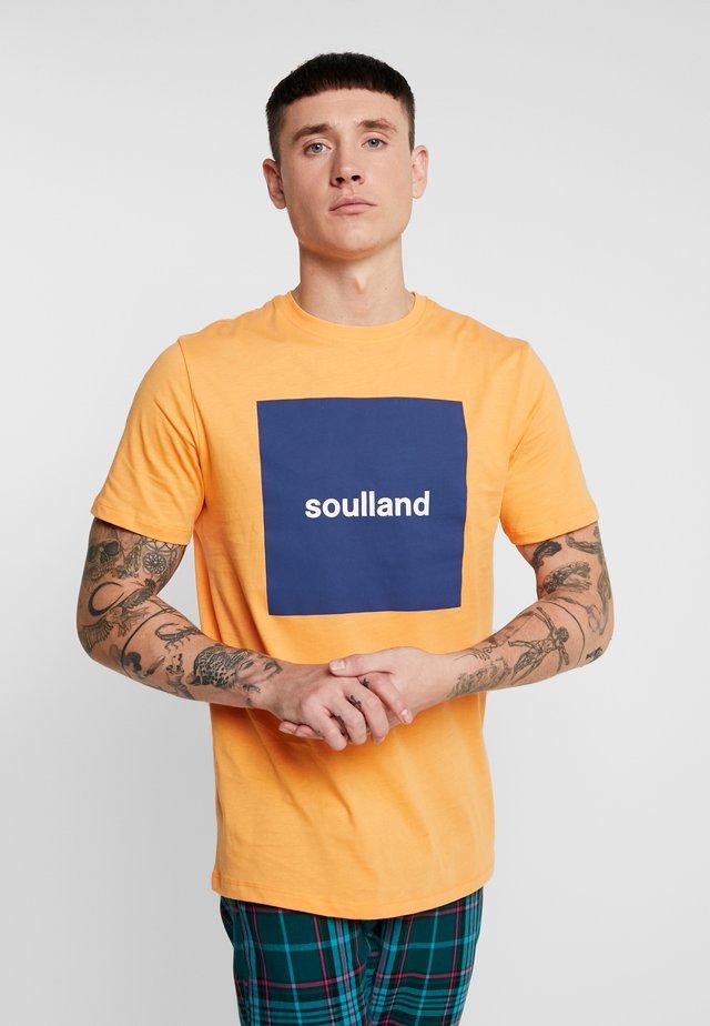 MANSON - Print T-shirt - orange
