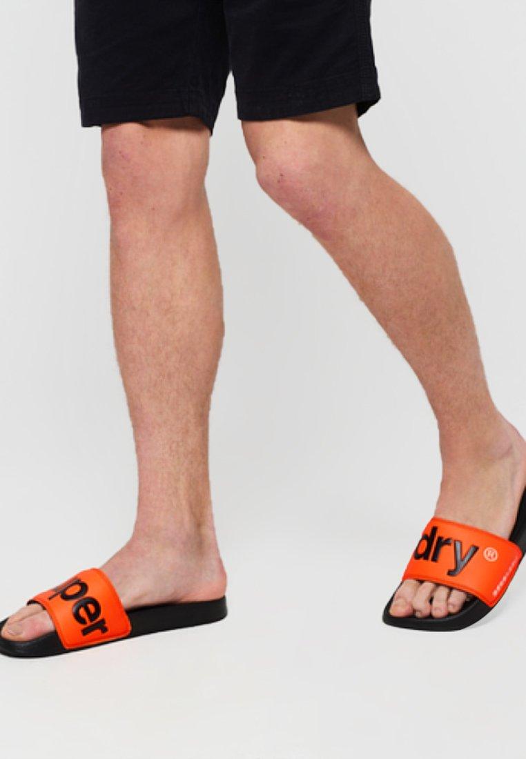 Superdry - POOL SLIDE - Badesandale - black / neon orange / white
