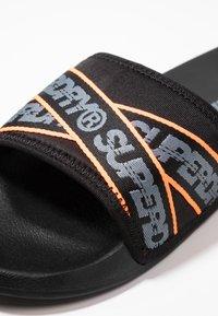 Superdry - CITY BEACH SLIDE - Mules - black/charcoal/hazard orange - 5