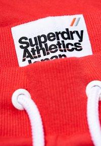 Superdry - ATHLETIC - Verryttelyhousut - red - 3