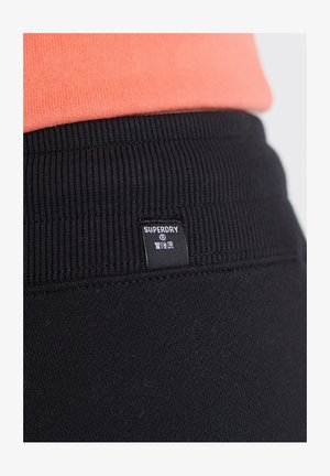 STANDARD LABEL  - Pantalones deportivos - black