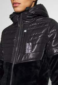 Superdry - STORM PANEL HYBRID - Summer jacket - black - 4