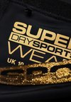 Superdry - BOLT  - kurze Sporthose - black