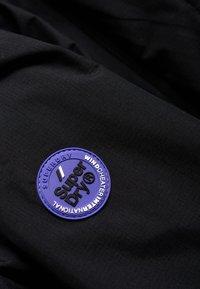 Superdry - POP ARCTIC  - Light jacket - noir/framboise - 6