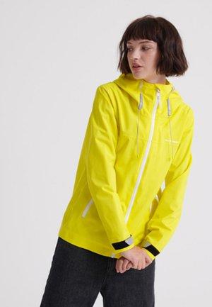 HARPA - Regenjas - yellow