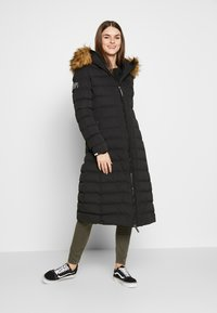 Superdry - NEW ARCTIC LONG PUFFER - Winter coat - black - 0
