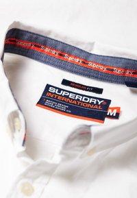 Superdry - INTERNATIONAL POPLIN - Chemise - white - 4