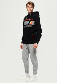 Superdry - Pantalones deportivos - light grey - 1