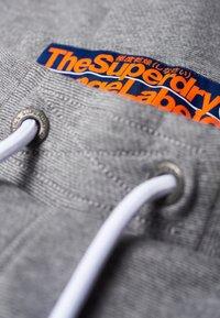 Superdry - ORANGE LABEL  - Pantalones deportivos - hammer grey grindle - 3