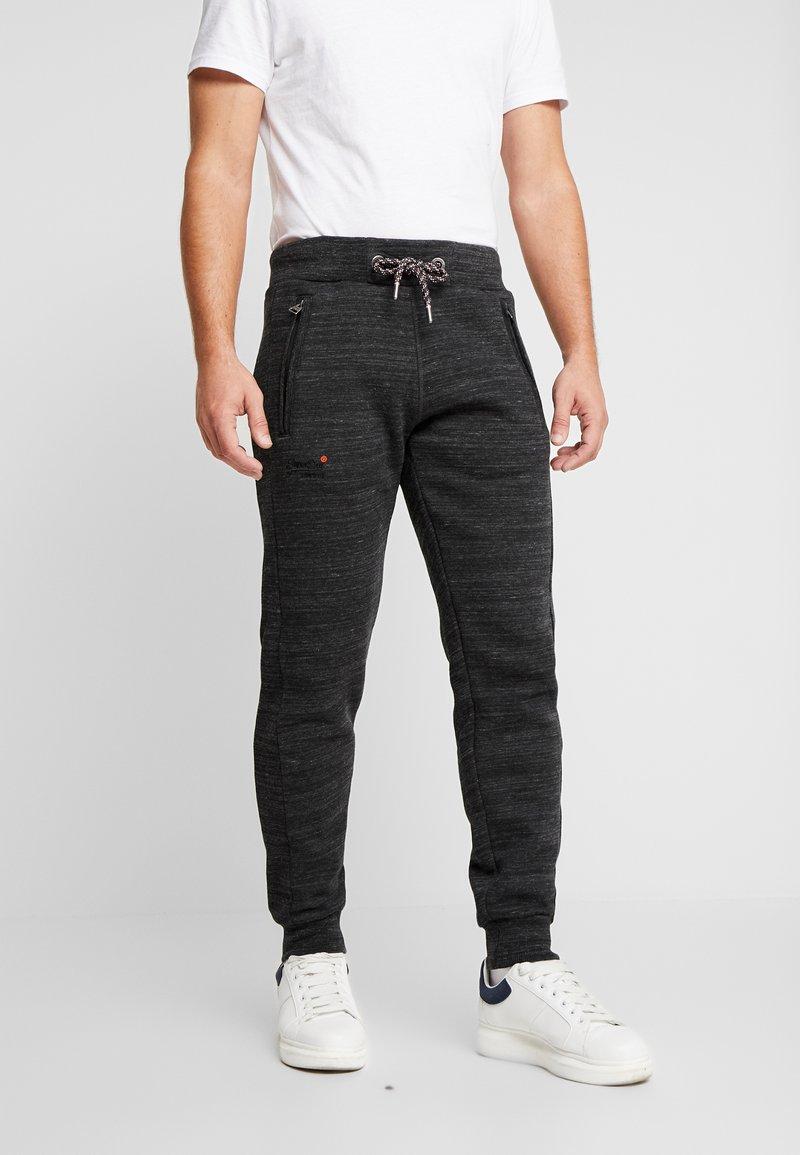 Superdry - CALI - Teplákové kalhoty - vast black space dye