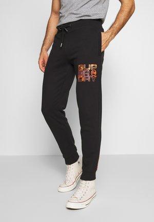 SPLIT CAMO JOGGER - Pantalon de survêtement - black