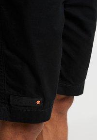 Superdry - WORLD WIDE - Shorts - black - 4