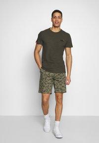 Superdry - INTERNATIONAL  - Shorts - dark green - 1
