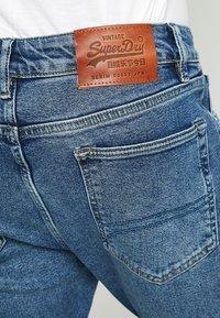 Superdry - TYLER - Slim fit jeans - alder mid blue - 5