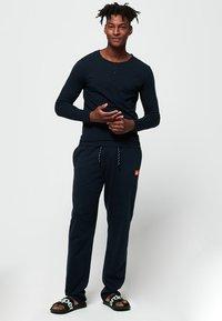 Superdry - Långärmad tröja - laundry navy blue - 1