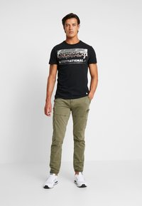 Superdry - RETRO SPORT TEE - Print T-shirt - black/silver - 1