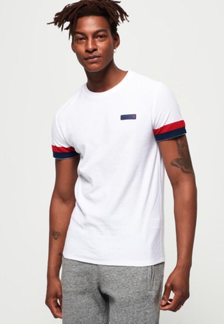 Superdry - INTERNATIONAL ENGINEERED - T-Shirt print - optical white
