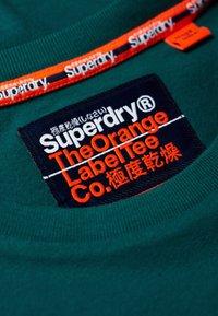 Superdry - LEKKI  - T-shirt basic - gasoline green - 4