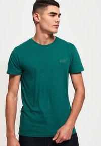 Superdry - LEKKI  - T-shirt basic - gasoline green - 0