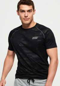 Superdry - T-shirt con stampa - black - 0