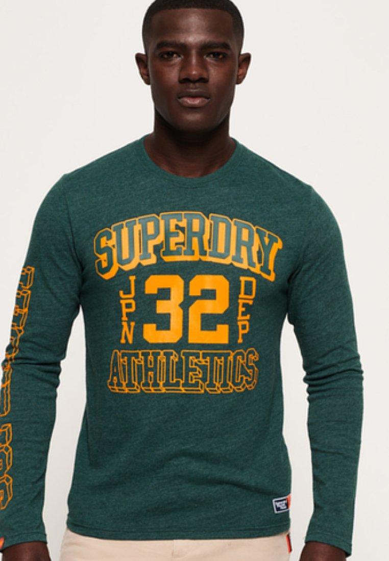 Green LonguesDark Superdry T shirt Manches À qLSMzUVGjp