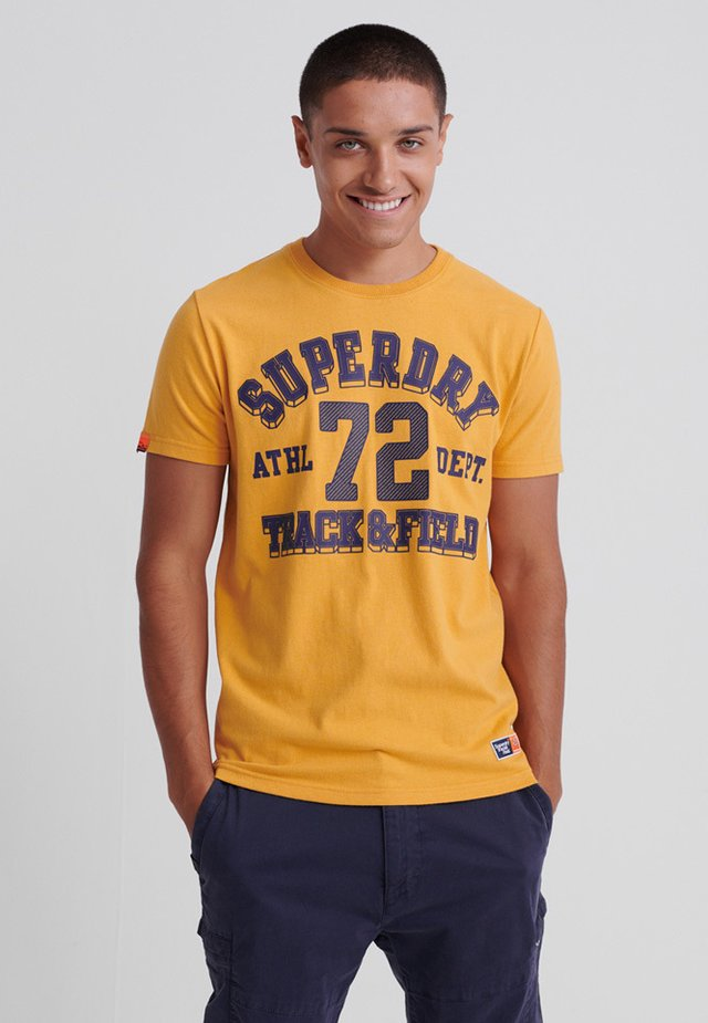 TRACK & FIELD  - T-shirt print - golden yellow