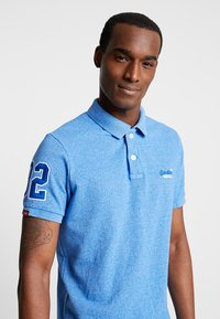 Superdry - CLASSIC - Polo shirt - ocean blue grit