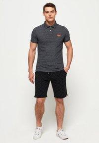 Superdry - LABEL  - Poloshirt - black - 1