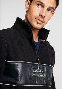 Superdry - POLAR INTERNATIONAL TRACK - Fleece trui - black - 6