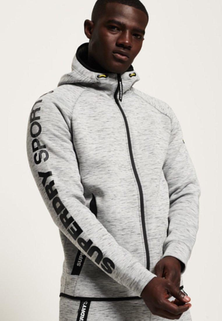 CORE GYM TECH veste en sweat zippée light gray