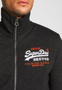 Superdry - PREMIUM GOODS TRACK TOP - Zip-up hoodie - oxide black feeder - 4