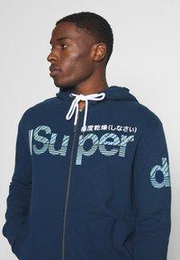 Superdry - CORE SPLIT LOGO ZIP HOOD - Zip-up hoodie - pilot mid blue - 3
