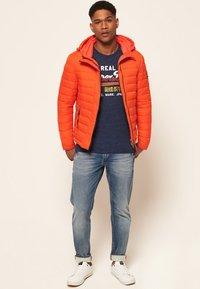 Superdry - NEW FUJI - Light jacket - orange intense - 1