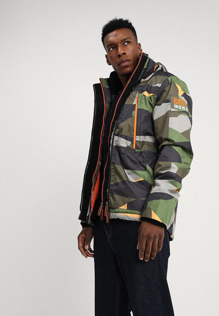 Superdry - HOODED POLAR WIND ATTACKER - Light jacket - pop geo camo/fluro orange