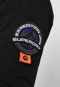 Superdry - EVEREST  - Giacca invernale - black - 7