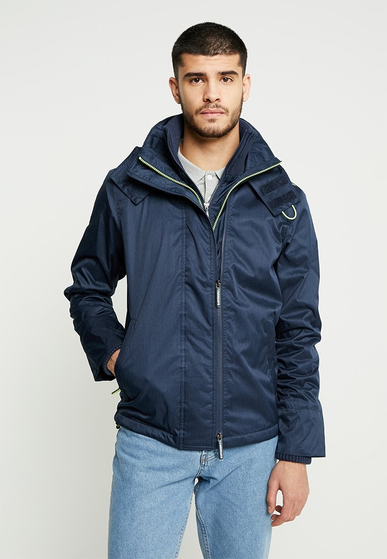 Superdry - HOODED ARCTIC POP ZIP - Leichte Jacke - navy marl/lime soda